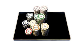 Poker chips on modern tablet Stock Photos