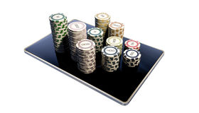 Poker chips on modern tablet Stock Photography