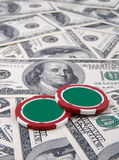 Poker chips and money. On money background Stock Images
