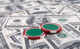 Poker chips and money. On money background Royalty Free Stock Image