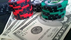 Poker chips, money on a laptop. Poker chips & money on a laptop Royalty Free Stock Photos