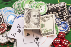 Poker chips, money,playing cards Stock Photos