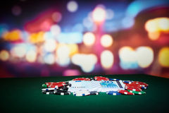 Poker chips with money Royalty Free Stock Photos