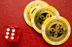 Poker chips and number 6 dice Royalty Free Stock Image