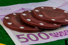 Poker chips over five hundreed euros banknote Stock Photos
