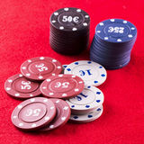 Poker chips over red cloth Royalty Free Stock Photo