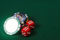 Poker chips and pair of dice Royalty Free Stock Image