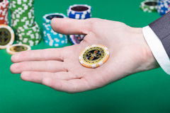 Poker chips in the palm of a man Royalty Free Stock Photos