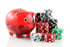 Poker chips with a piggy bank Stock Photos
