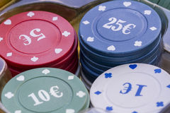 Poker chips. Pile of poker chips on table Stock Image