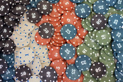 Poker chips. Plastic poker chips with numbers Royalty Free Stock Images