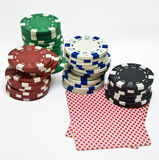 Poker chips and playing card Stock Images