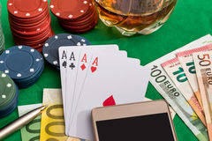 Poker chips with playing card, euro and smartphone Royalty Free Stock Photos