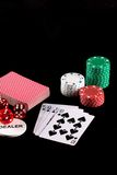 Poker chips and playing cards. Poker chips, dice and playing cards on a black background Royalty Free Stock Photography