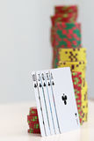 Poker chips and playing cards. Close up on poker chips and playing cards Royalty Free Stock Photo