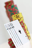 Poker chips and playing cards. Close up on poker chips and playing cards Stock Images