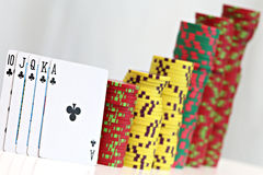 Poker chips and playing cards. Close up on poker chips and playing cards Stock Image