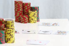 Poker chips and playing cards. Close up on poker chips and playing cards Stock Photography