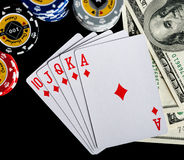 Poker chips Playing cards and dollars Royalty Free Stock Photos