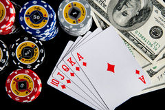 Poker chips Playing cards and dollars Stock Photography