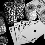 Poker chips Playing cards and dollars Royalty Free Stock Image