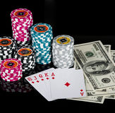 Poker chips Playing cards and dollars Stock Image