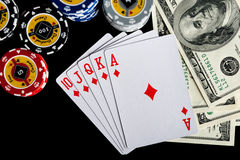 Poker chips Playing cards and dollars Royalty Free Stock Images