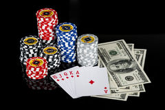 Poker chips Playing cards and dollars Stock Images