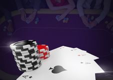 Poker chips and playing cards in front of dark casino table background. Digital composite of Poker chips and playing cards in front of dark casino table Stock Images