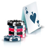 Poker chips and playing cards pyramid Stock Images