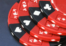 Poker chips- red and black. Stack of red and black gaming chips Royalty Free Stock Photos