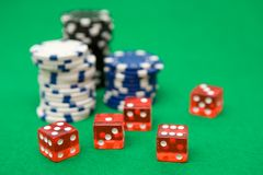 Poker Chips and Red Dice Stock Images
