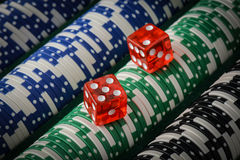 Poker Chips and Red Dice Stock Photo