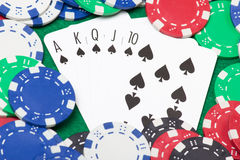 Poker chips and royal flush combination at poker on the green ta Stock Photos