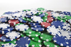 Poker chips scattered. Lots of poker chips scattered as a background texture royalty free stock photo