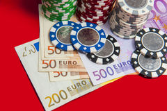 Poker chips stack with euro bills Stock Photography