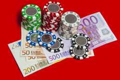 Poker chips stack with euro bills Stock Photo