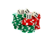 Poker chips stacked and dice. Royalty Free Stock Photos