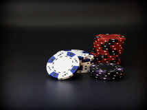 Poker chips. Stacks of poker chips on a black background Stock Photos