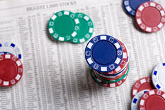 Poker chips on a financial report Royalty Free Stock Photo