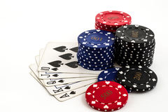 Poker chips  and a straight flush on a white background. Royalty Free Stock Images