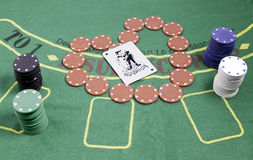 Poker chips and table Royalty Free Stock Photography