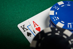 Poker chips on table with cards Stock Photos