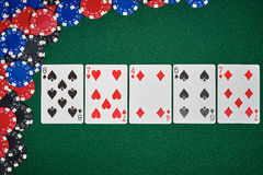 Poker chips on table with cards. Poker chips with cards on green table in casino Royalty Free Stock Photography