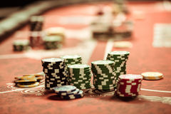 Poker chips on table in casino. Close up view of poker chips on table in casino stock photos