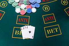 Poker chips on a table at the casino. Poker chips on a poker table at the casino. Closeup. four aces, a winning combination. Chips winner royalty free stock images