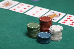 Poker chips on a poker table. In Texas Hold`em Royalty Free Stock Photography