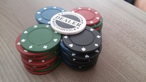 Poker chips texas holdem. Blue red green black Royalty Free Stock Photo