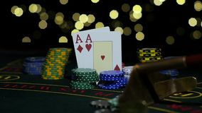 Poker Chips and Two Aces. Close up. Slow motion stock video footage