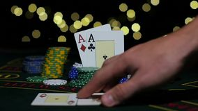 Poker Chips and Two Aces. Dealer takes all poker chips. Close up. Slow motion. Poker Chips and Two Aces. Dealer takes all poker chips, pair of aces, rolling one stock footage